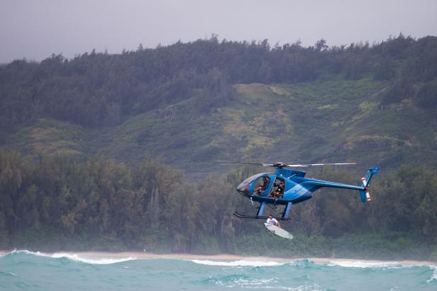 Helicopter Drops Surfer
