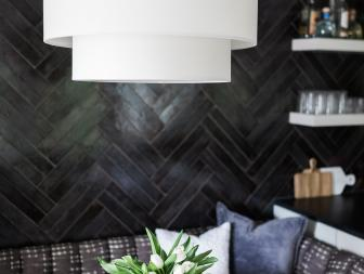 Multipurpose Basement with Black Herringbone Tile