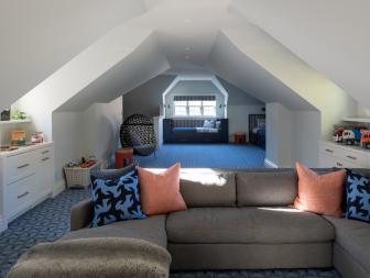Playroom With Angled Ceiling, Sitting Area and Blue Carpet