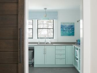 Blue Laundry Room With Barn Door