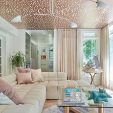 Pink Living Room With Wallpapered Ceiling