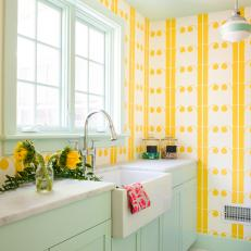 Eclectic Yellow Laundry Room With Blue Cabinets