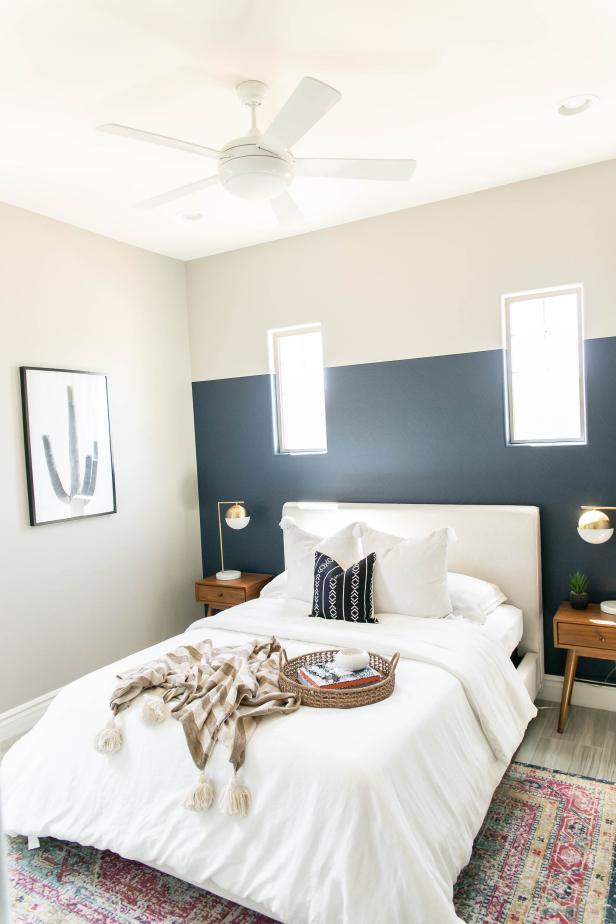 scandinavian bedroom with blue accent wall  hgtv