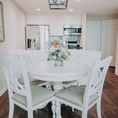White Dining Table With Cushioned Chairs