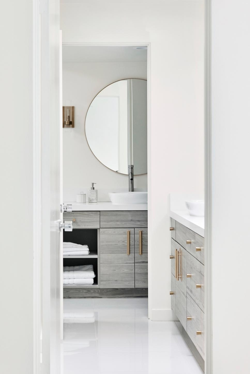 Modern Clean Bathroom With Double Vanities And Brass Pulls