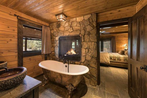 Rustic Master Bathroom with Fireplace and Clawfoot Tub