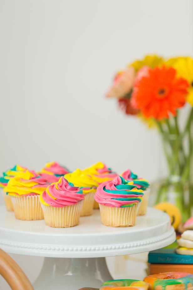 Pink, Green and Yellow Tie-Dye Icing on Top of a Cupcake