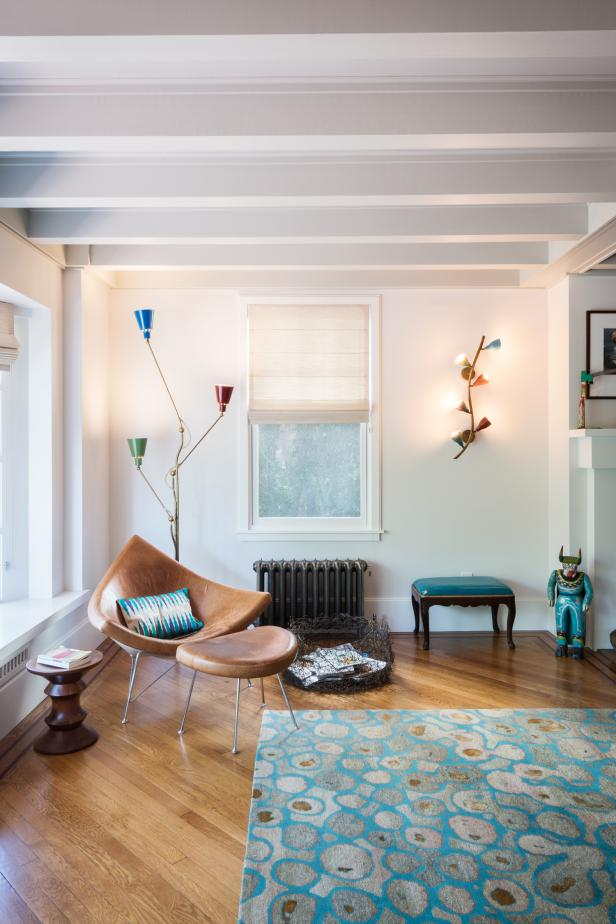 Exposed Beams In Reading Nook With A Midcentury Leather Chair
