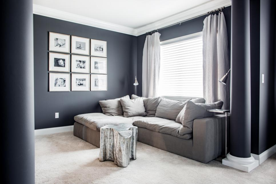 Master Suite Seating Area With Sofa Beside Framed Art Gallery Wall