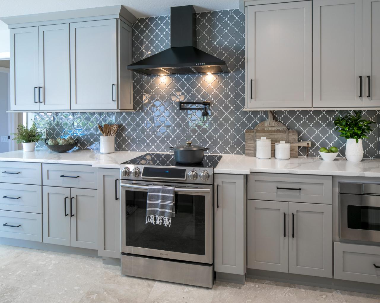- Gray Kitchen With Decorative Counter-To-Ceiling Backsplash HGTV
