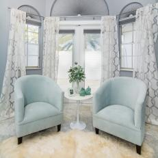 Gray Sitting Area With Blue Chairs