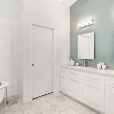 White Master Bathroom With Blue Accent Wall