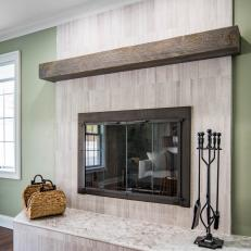 Brown Fireplace With Reclaimed Wood Mantel