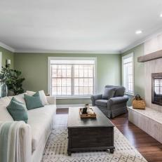 Green Transitional Living Room With Limestone Fireplace