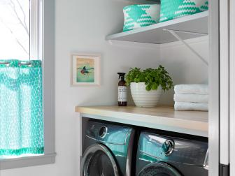 Colorful Laundry Room With Patterned Floor Tiles