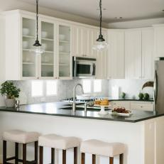 Open Plan Transitional Kitchen With White Stools