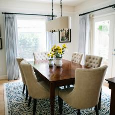 Transitional Dining Room With Blue Rug