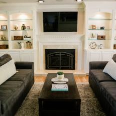 Transitional Living Room With Dark Sofas