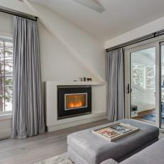 Fireplace and Gray Curtains
