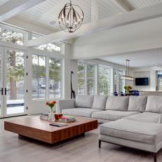 White Open Plan Living Room With Pond View