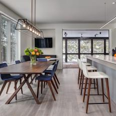 Open Plan Dining Area With Blue Chairs