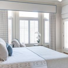 Blue and White Transitional Master Bedroom With Orchid