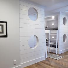 Black-And-White Bunk Beds With Nautical Portholes