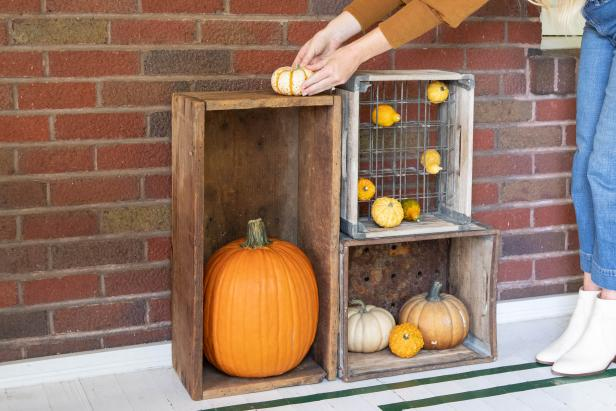 A Vertical Display of Vintage Crates With Fall Gourds