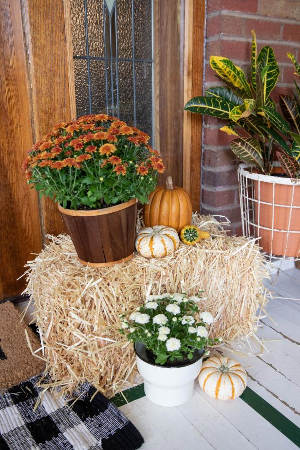 Straw Bale Surrounded by Fall Decor on Porch