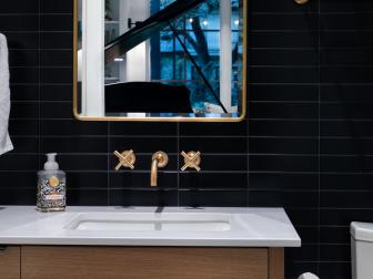 Black Small Bathroom With Brass Mirror