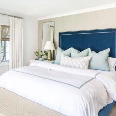 Neutral Transitional Bedroom With Blue Bed