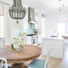 White Cottage Eat In Kitchen WIth Silver Chandelier