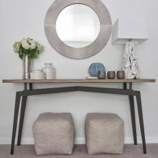 Gray Console Table and Silver Vase