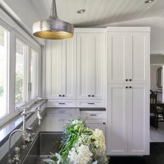 White Kitchen With Flowers in Sink