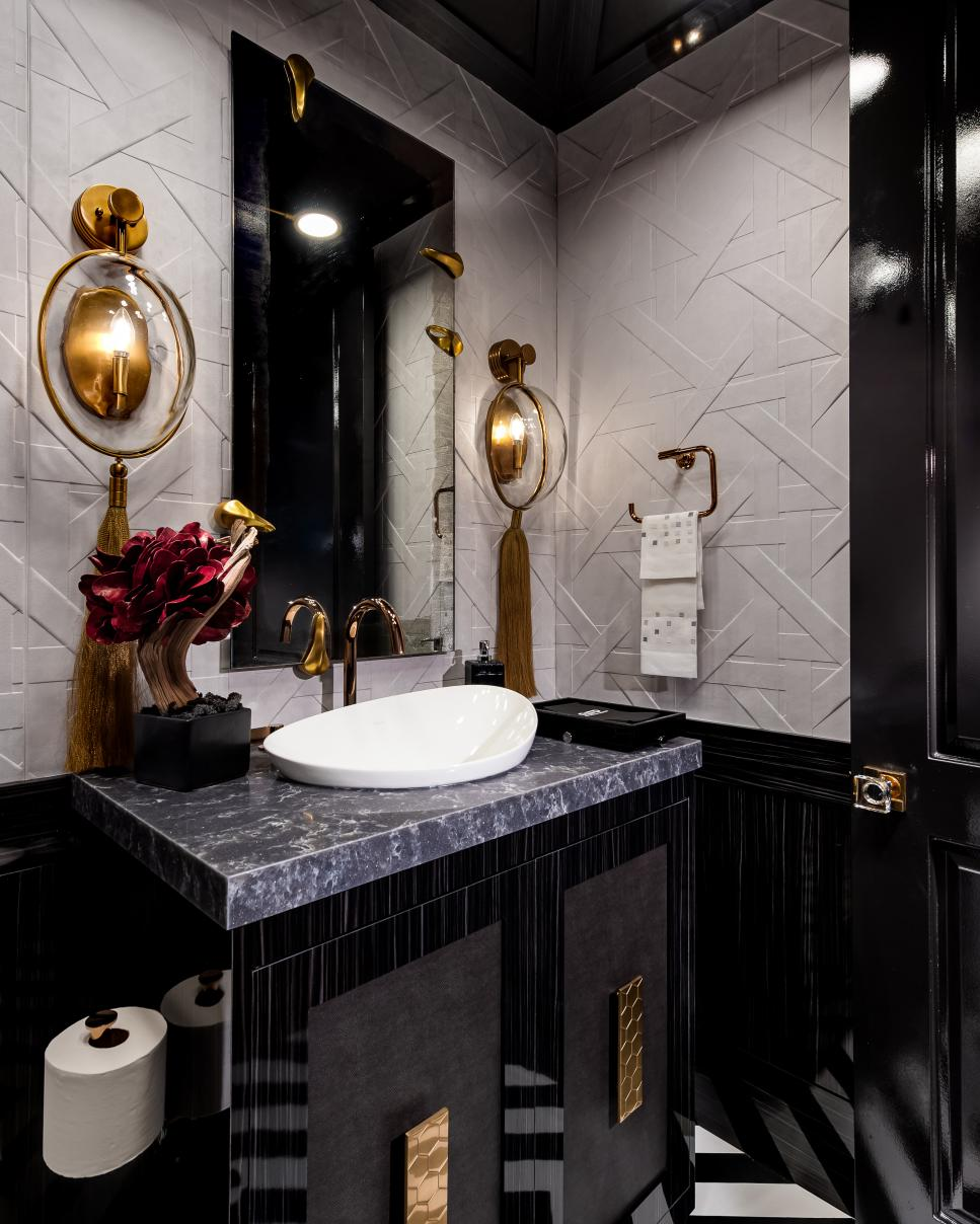 Powder Room With Gold Sconces