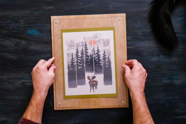 Hands Holding Finished Magnetic Acrylic Frame With Photo of Trees