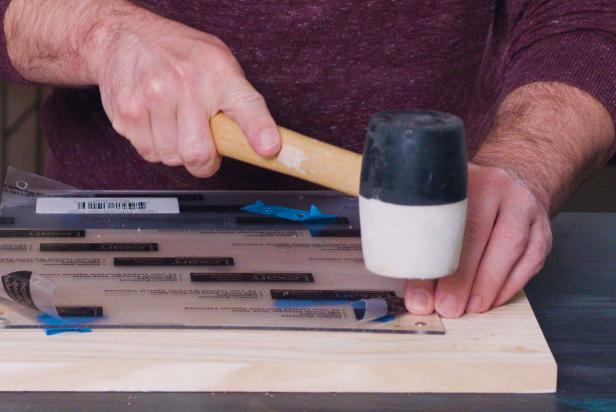 Using a rubber mallet, tap each magnet into the drilled holes. Magnets should be inserted into both acrylic and wood pieces.