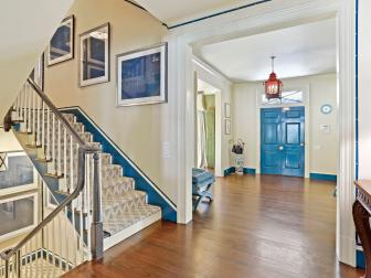 Foyer and Stairs With Blue Trim
