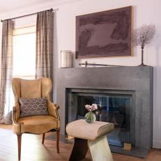 Leather Armchair and Gray Fireplace
