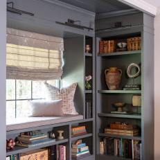 Gray Window Seat and Bookshelves