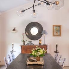 Eclectic Dining Room With Round Mirror