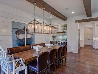 Modern Farmhouse Dining Room With Exposed Beams and Farm Table