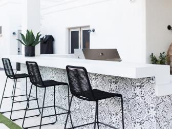 Covered Outdoor Kitchen With Black-And-White Tile Bar