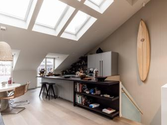Skylights Light a Modern Open Concept Living Area That Features a Galley Kitchen