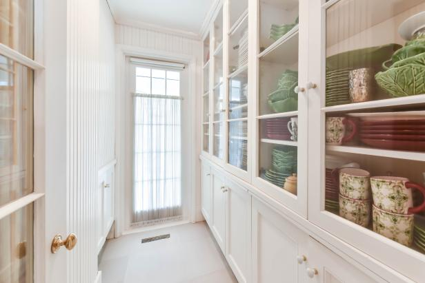 Narrow Pantry Room With Oversized Window, Row of Glass Door Cabinets