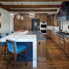 Rustic Chef Kitchen With Blue Barstools