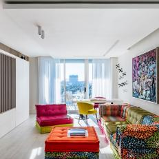 Multicolored Sitting Room With Orange Ottoman