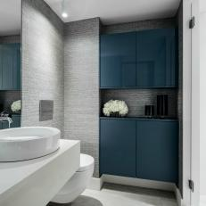 Gray Bathroom With Blue Cabinets
