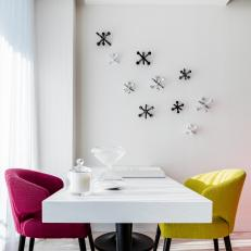 Modern Dining Room With Multicolored Chairs