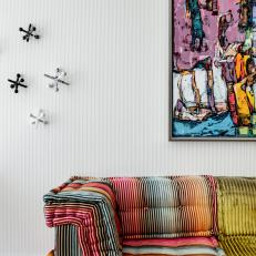 Multicolored Sofa and Artwork
